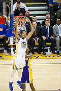 Golden State Warriors guard Shaun Livingston (34) finish a dunk against the Los Angeles Lakers at Oracle Arena in Oakland, Calif., on November 23, 2016. (Stan Olszewski/Special to S.F. Examiner)