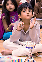 Children watching the celebrations for Navratri; the Hindu festival of Nine Nights,