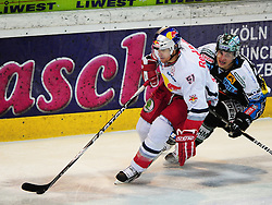 27.01.2012, Keine Sorgen Eisarena, Linz, AUT, EBEL, EHC Liwest Black Wings Linz vs EC Red Bull Salzburg, at the picture Brian Lebler (Liwest Black Wings Linz, #7) and Matthias Trattnig (EC Red Bull Salzburg, #51), during the Erste Bank Icehockey League, Keine Sorgen Eisarena, Linz, Austria, 2012-01-27, EXPA Pictures © 2012, PhotoCredit: EXPA/ Reinhard Eisenbauer