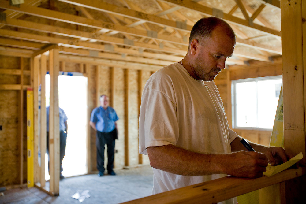 Prairie Gold Homes are built through a collaboration of many partners:.Nebraska Housing Rescources.Nebraska Dept. of Correctional Services.Cornhusker State Industries.Nebraska Investment Finance Authority.Federal Home Loan Bank of Topeka.Vantage Pointe Homes.Nebraska Dept. of Economic Development..The idea is create affordable housing for Nebraskans while providing strucutred job skills training for minimum security inmates.  ..Images are of inmates from the Nebraska State Pennitentiary working on building homes for families in rural areas of Nebraska.