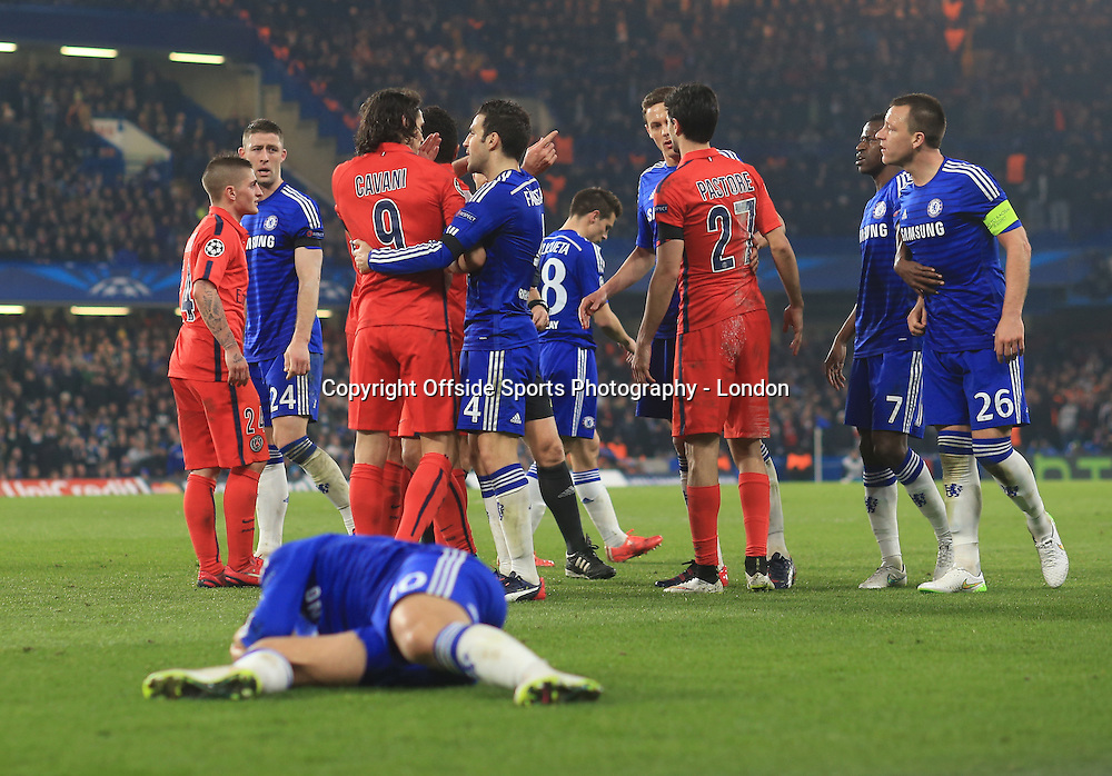 11 March 2015 Champions League Football - Chelsea v Paris Saint-Germain : Players confront each other as Hazard lies injured on the floor.<br /> Photo: Mark Leech