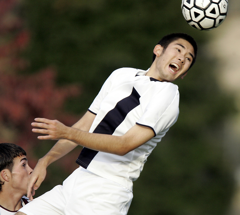 Purchase, NY / 2008 - Keio Academy's Jun Shimazaki jumps to head the ball toward the goal during a varsity soccer game between Harrison and Keio at Keio Academy in Purchase Oct. 14, 2008.  Keio Academy won the game in overtime, 3-2. ( Mike Roy / The Journal News )