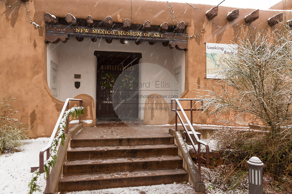The adobe style New Mexico Museum of Art in the historic district during a winter snowfall December 12, 2015 in Santa Fe, New Mexico.