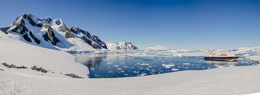 National Geographic Explorer anchored at Booth Island at Port Charcot in Antarctica.