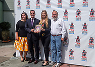 Los Angeles Mayor Eric Garcetti, l2nd eft, receives the first commemorative, full-color souvenir book to mark the 90-year history of the TCL Chinese Theatre, on Monday, July 24, 2017, in Los Angeles  (Photo by Ringo Chiu)<br /> <br /> Usage Notes: This content is intended for editorial use only. For other uses, additional clearances may be required.