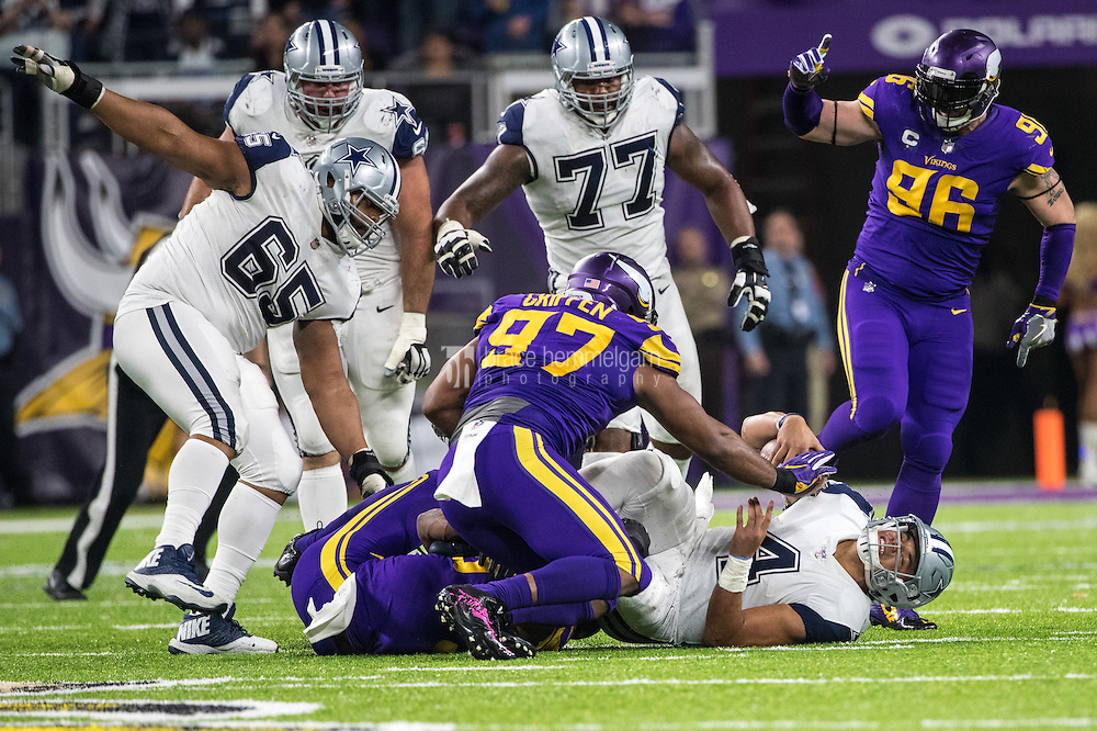 Dec 1, 2016; Minneapolis, MN, USA; Dallas Cowboys quarterback Dak Prescott (4) is sacked during the fourth quarter against the Minnesota Vikings at U.S. Bank Stadium. The Cowboys defeated the Vikings 17-15. Mandatory Credit: Brace Hemmelgarn-USA TODAY Sports