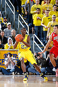 ANN ARBOR, MI - DECEMBER 14: Caris LeVert #23 of the Michigan Wolverines passes the ball against the Arizona Wildcats during the game at Crisler Center on December 14, 2013 in Ann Arbor, Michigan. Arizona won the game 72-70. (Photo by Joe Robbins)
