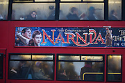 London bus passengers endure the misery of another morning commute into the city unaware of Narnia movie poster.