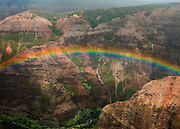 A rainbow appears over Makalena Mountains near the Alaka'i Swamp, during a helicopter ride with Sunshine Helicopter out of the town of Lihu'e on Kaua'i Hawaii.