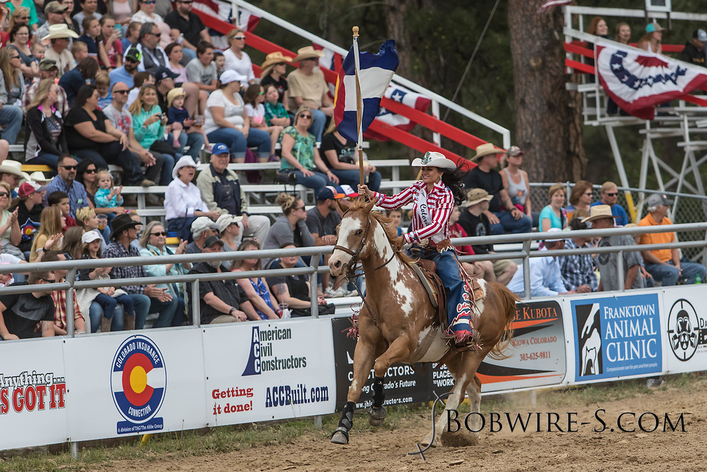 Miss Rodeo Colorado Alex Hyland brings in the Colorado flag during the third performance of the Elizabeth Stampede on Sunday, June 3, 2018.
