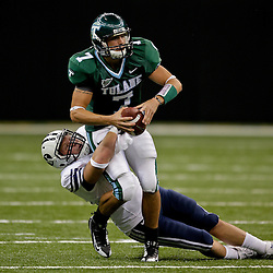 Sep 12, 2009; New Orleans, LA, USA; Tulane Green Wave quarterback Joe Kemp (7) is grabbed from behind by BYU Cougars defensive tackle Jan Jorgensen (84) during the first half at the Louisiana Superdome.  BYU defeated Tulane 54-3. Mandatory Credit: Derick E. Hingle-US PRESSWIRE