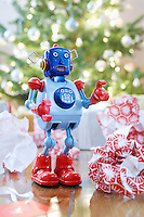 Toy robot in front of Christmas tree