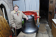 "UK, November 24 2014:  Brian Horrell stands next to the new tenor bell that will be installed at All Saints East Budleigh church. The inscription on the bell states ""Anne and Brian Horrell married at All Saints East Budleigh 6th June 1959"" . Copyright 2014 Peter Horrell."