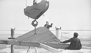 """AMAZING Photo Film discovered Documenting Work In Chernobyl <br />Chernobyl worker Aleksandr Shubovskiy captures rare images <br /><br />During one of the days in 1979-80, when the erection of Ventilation Stack VT-2 common for the third and fourth (not existed at that time) Chernobyl NPP Units was coming to the end, Aleksandr Shubovskiy, who was working within a combined installation crew in a company named """"Spetsenergomontazh"""", arranged with the colleagues a small photo session on his own,They had their pictures taken.<br /><br />The author processed the film and put it on a wardrobe without printing until he had time to print the images. The moment to print the film somehow did not happen, while in February 1986 Aleksandr hit the road for a on a different site in Yakutia. And there he was caught by news about the accident at Chernobyl.<br /><br />A year later, when a Aleksandr  managed to get into his looted flat in the evacuated Pripyat, he discovered an untouched package with films. He brought them home and… forgot for almost 40 years…the printed photographs which no one and never have seen before until now<br /><br />Photo shows: The Stack was constructed section by section. Total 154 meters were lifted over a period of two months.<br />©Aleksandr Shubovskiy/Exclusivepix Media"""