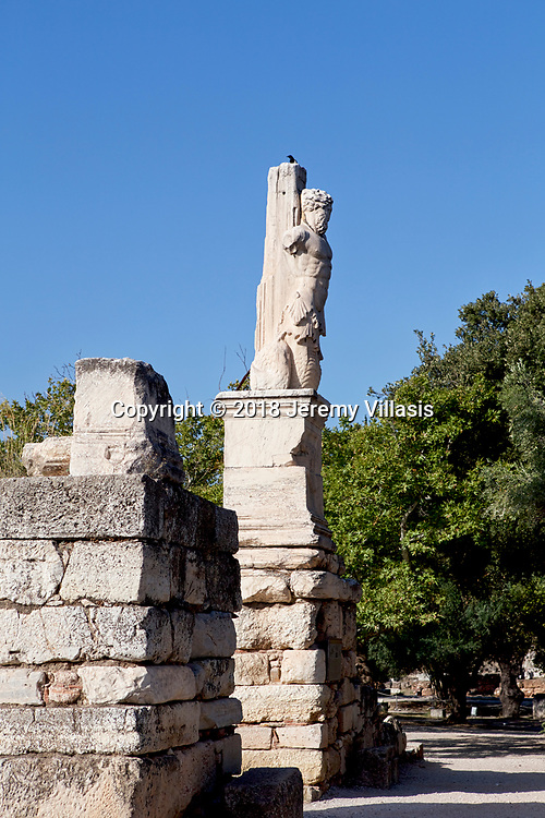Statue of Triton at the Atrium of the Giants of the Odeion of Agrippa, a Roman addition to the Ancient Agora of Athens in Greece.<br /> <br /> Built around 15 BC, the Odeion was a large concert hall located in the centre of the Ancient Agora.