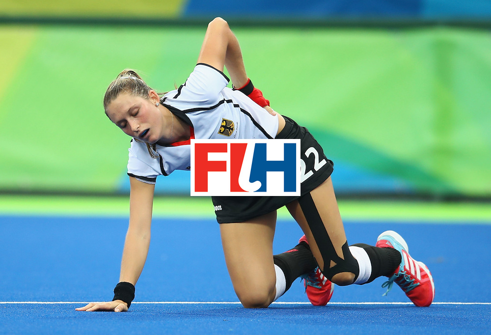 RIO DE JANEIRO, BRAZIL - AUGUST 10:  Cecile Pieper of Germany is injured during the Women's Pool B Match between Germany and Korea on Day 5 of the Rio 2016 Olympic Games at the Olympic Hockey Centre on August 10, 2016 in Rio de Janeiro, Brazil.  (Photo by Mark Kolbe/Getty Images)