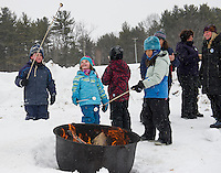 Oliver Leandro, Emmaline Leandro, Nathan Hobby and Greta Baker cook marshmallows over the fire during Winterfest activities at Prescott Farm on Saturday afternoon.  (Karen Bobotas/for the Laconia Daily Sun)