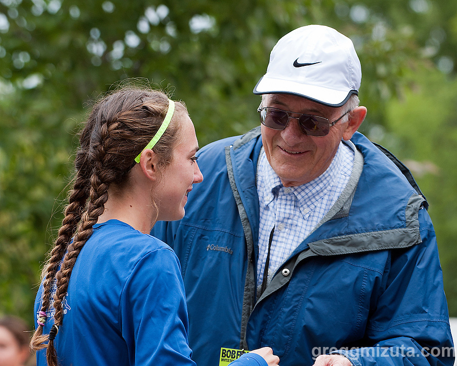 Bob Firman congratulates Makena Morley, winner of the Elite girls race and new course record holder, at the Bob Firman Invitational on September 27, 2014 at Eagle Island State Park, Eagle, Idaho.