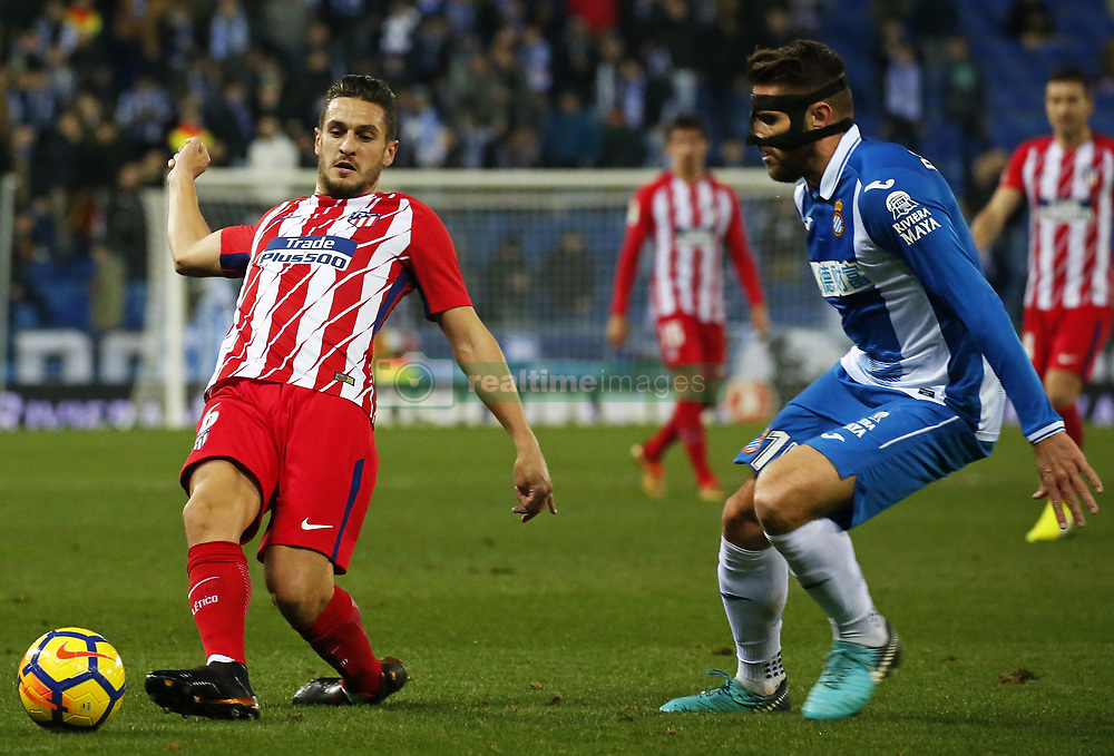 December 22, 2017 - Barcelona, Spain - Koke and David Lopez during the La Liga match between RCD Espanyol and Atletico de Madrid, in Barcelona, on December 22, 2017. Photo: Joan Valls/Urbanandsport/Nurphoto  (Credit Image: © Joan Valls/NurPhoto via ZUMA Press)