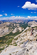 Climber on the summit of Tenaya Peak, Tuolumne Meadows area, Yosemite National Park, California