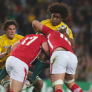 Radike Samo, Australia, is tackled by Ryan Bevington, (left) and Alun Wyn Jones, Wales,  during the Australia V Wales Bronze Final match at the IRB Rugby World Cup tournament, Auckland, New Zealand. 21st October 2011. Photo Tim Clayton...