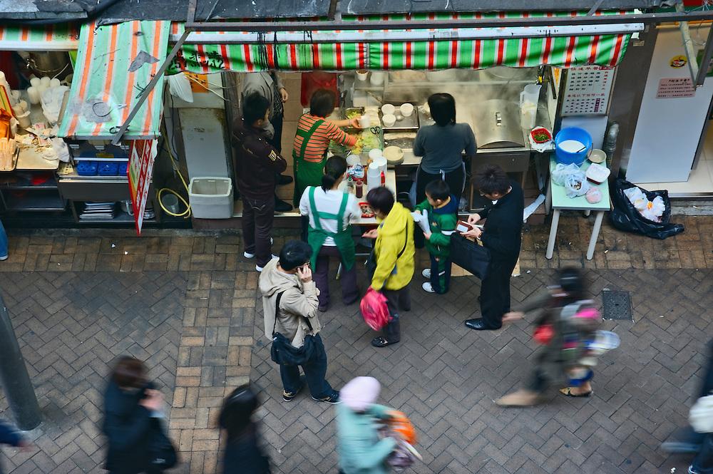 Hong Kong residents line up for breakfast at food shop, Wan Chai district, Hong Kong