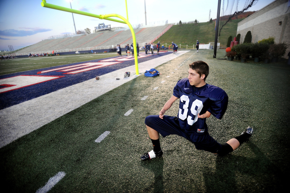"""Liberty University kicker Ben Shipps stretches at a practice at Williams Stadium.  Shipps was born was an arm deformity has been able to overcome the odds and is now kicking for the team.  """"When people say I can't do something that really pushes me and I want to prove them wrong and show them that anything can be done through the power of God."""""""