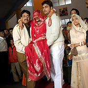 The bride bids farewell to her parents and siblings and other members of her family. A Rajput wedding in India