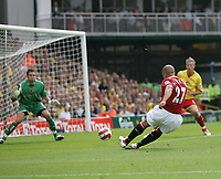 Photo: Lee Earle.<br /> Watford v Manchester United. The Barclays Premiership. 26/08/2006. United's Mikael Silvestre (r) slots the ball past Watford keeper Richard Lee.