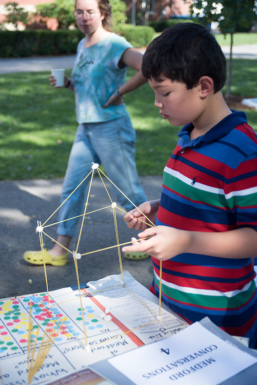9/24/17 – Medford/Somerville, MA – Child builds a house with spaghetti during Tufts Community Day on September 24. (Seohyun Shim / The Tufts Daily)