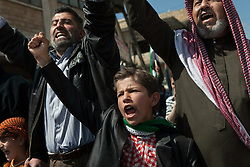 A boy shouting words of freedom in a demonstration against the Syrian regime led by Bashar-al-Assad in Anadan, 8 kilometres north from Aleppo North Syria, friday, April 20, 2012..*In this small town, 10 people were found dead, 15 wounded and one missing in an attack where 18 tanks, 14 military cars and around 300 soldiers burned down 118 houses and 120 shops in a operation by the Syrian regime of Bashar-Al-Assad on April 13th and 14th activist says, Syria, April 20, 2012. Photo by Daniel Leal-Olivas / i-Images.