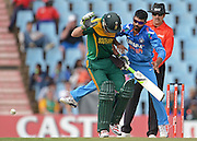 PRETORIA, South Africa, 11 December 2013. AB de Villiers of South Africa under attack by the bowler during the 3rd ODI Cricket match between South Africa and India at Super Sport Park in Centurion Pretoria, South Africa on Wednesday 11 December 2013.<br /> Photographer : Anton de Villiers / SASPA