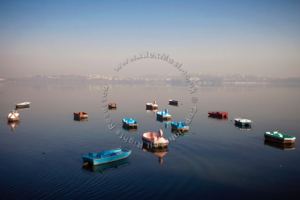 In the early morning, boats are anchored next to the city's MP Tourism Boat Club, on Bhopal's Upper Lake, (or Bhojtal) Asia's largest artificial lake, built by Parmara Raja Bhoj during his tenure as a king of Malwa (1005–1055), in Bhopal, Madhya Pradesh, India, city of the infamous '1984 Gas Disaster', a tragic event that today continues to consume people's lives.