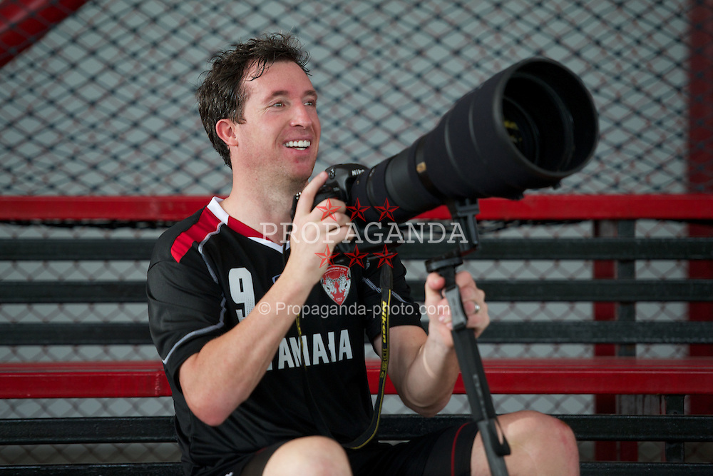 BANGKOK, THAILAND - Saturday, July 23, 2011: Former Liverpool player Robbie Fowler plays around with a camera after training with his new side Thailand football club, Muangthong United, at the Yamaha Stadium in Bangkok. (Photo by David Rawcliffe/Propaganda)