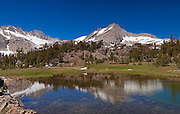 North Peak and Mt. Conness seen in an arm of Greenstone Lake, 20 Lakes Basin.
