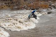 scott sady kayaking in high water at the Reno Whitewater Park.