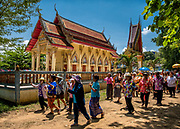 A procession around the ordination hall begins the Songkran festivities, April 14, 2017. PHOTO BY LEE CRAKER