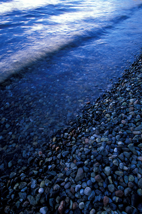 Small waves washing upon pebbles on Fallen Leaf Lake, CA.