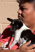 "MCDERMITT, NV - AUG 16:  Mona Smart waits with her dog ""Bubbles"" during a clinic sponsored by the Humane Society of the United States August 16, 2009 in McDermitt Nevada.  (Photograph by David Paul Morris)"