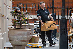 © Licensed to London News Pictures. 31/07/2018. London, UK. A wooden box with the words 'SOAP BOX' written on it is carried out of the official residence of the Foreign Secretary at Carlton Gardens in central London where former Foreign Secretary Boris Johnson has been living since his resignation. Photo credit: Rob Pinney/LNP