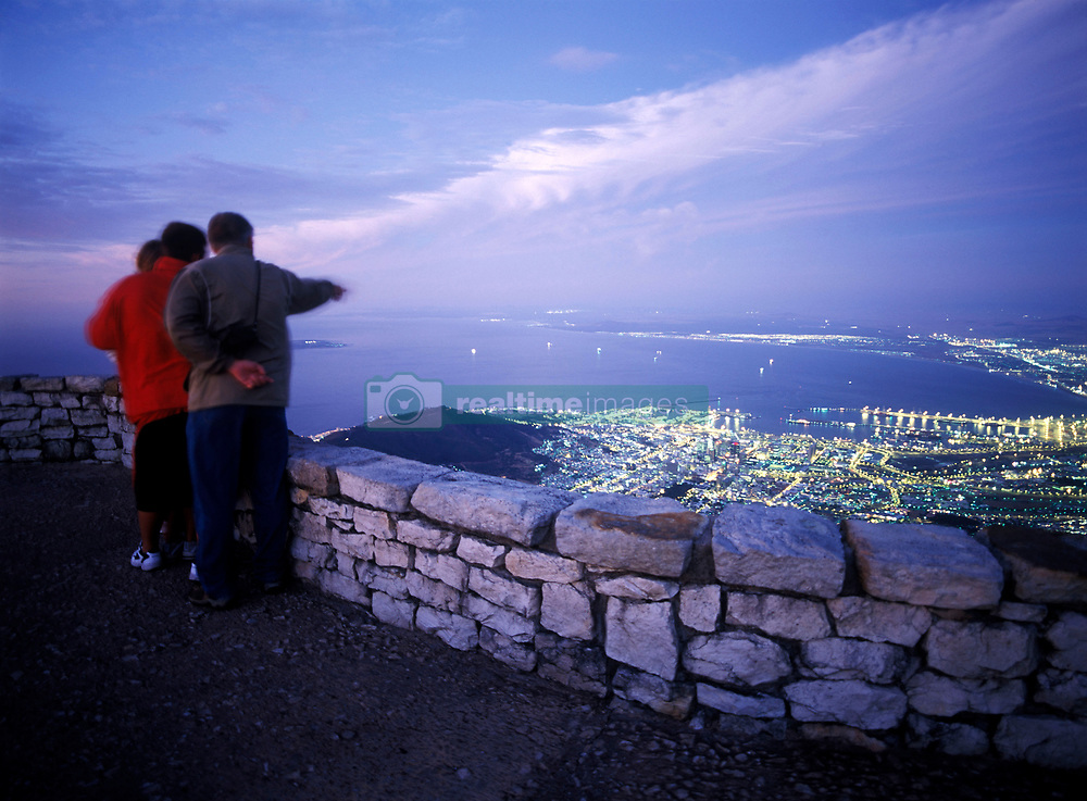 Family admiring the view of Cape Town at dusk as seen from the top of Table Mountain, South Africa. (Credit Image: © Axiom/ZUMApress.com)