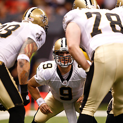 August 27, 2010; New Orleans, LA, USA; New Orleans Saints quarterback Drew Brees (9) in the huddle during the first half of a preseason game at the Louisiana Superdome. The New Orleans Saints defeated the San Diego Chargers 36-21. Mandatory Credit: Derick E. Hingle