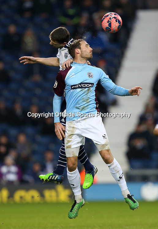 3rd January 2015 - FA Cup 3rd Round - West Bromwich Albion v Gateshead - Alex Rodman of Gateshead wins a header - Photo: Paul Roberts / Offside.