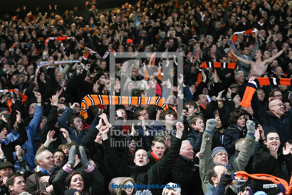 Picture by David Horn/Focus Images Ltd +44 7545 970036.26/01/2013.Luton Town fans celebrate a famous victory during the The FA Cup match at Carrow Road, Norwich.