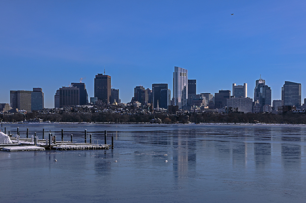 Winter in Boston skyline photography reflected in a frozen Charles River featuring iconic building and some of the tallest skyscrapers in Boston such as the Boston State Street Corporation, The Federal Reserve Bank of Boston, the Millennium Tower and the One Financial Center at Dewey Square on a bitter cold morning in winter. Boston winter photos are available as museum quality photography prints, canvas prints, acrylic prints, wood prints or metal prints. Fine art prints may be framed and matted to the individual liking and decorating needs at<br />