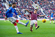 Aaron Hickey (#51) of Heart of Midlothian FC attempts to prevent Connor Goldson (#6) of Rangers FC clearing the ball during the Ladbrokes Scottish Premiership match between Heart of Midlothian and Rangers FC at Tynecastle Park, Edinburgh, Scotland on 20 October 2019.