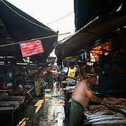 Row of fishmongers at Khlong Toei market, Bangkok