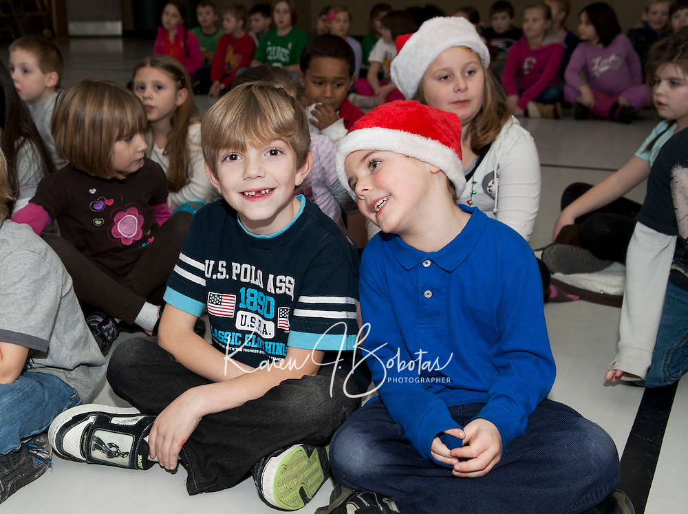 Joseph Baldi and Christopher participant in a sing - a - long prior to being dismissed from Elm Street School for their Christmas break Friday afternoon.  (Karen Bobotas/for the Laconia Daily Sun)