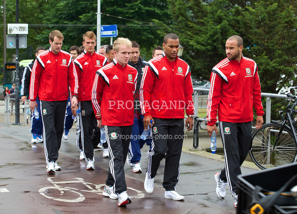 AMSTERDAM, NETHERLANDS - Tuesday, June 3, 2014: Wales' Jonathan Williams, Jermaine Easter and Ashley 'Jazz' Richards during a walk near their hotel ahead of the International Friendly match against the Netherlands. (Pic by David Rawcliffe/Propaganda)