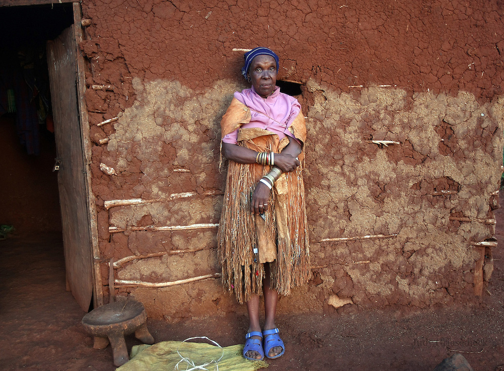 An elderly woman in Bossodawish, Tanzania, proudly wears an armful of bracelets crafted by her son, a local blacksmith.